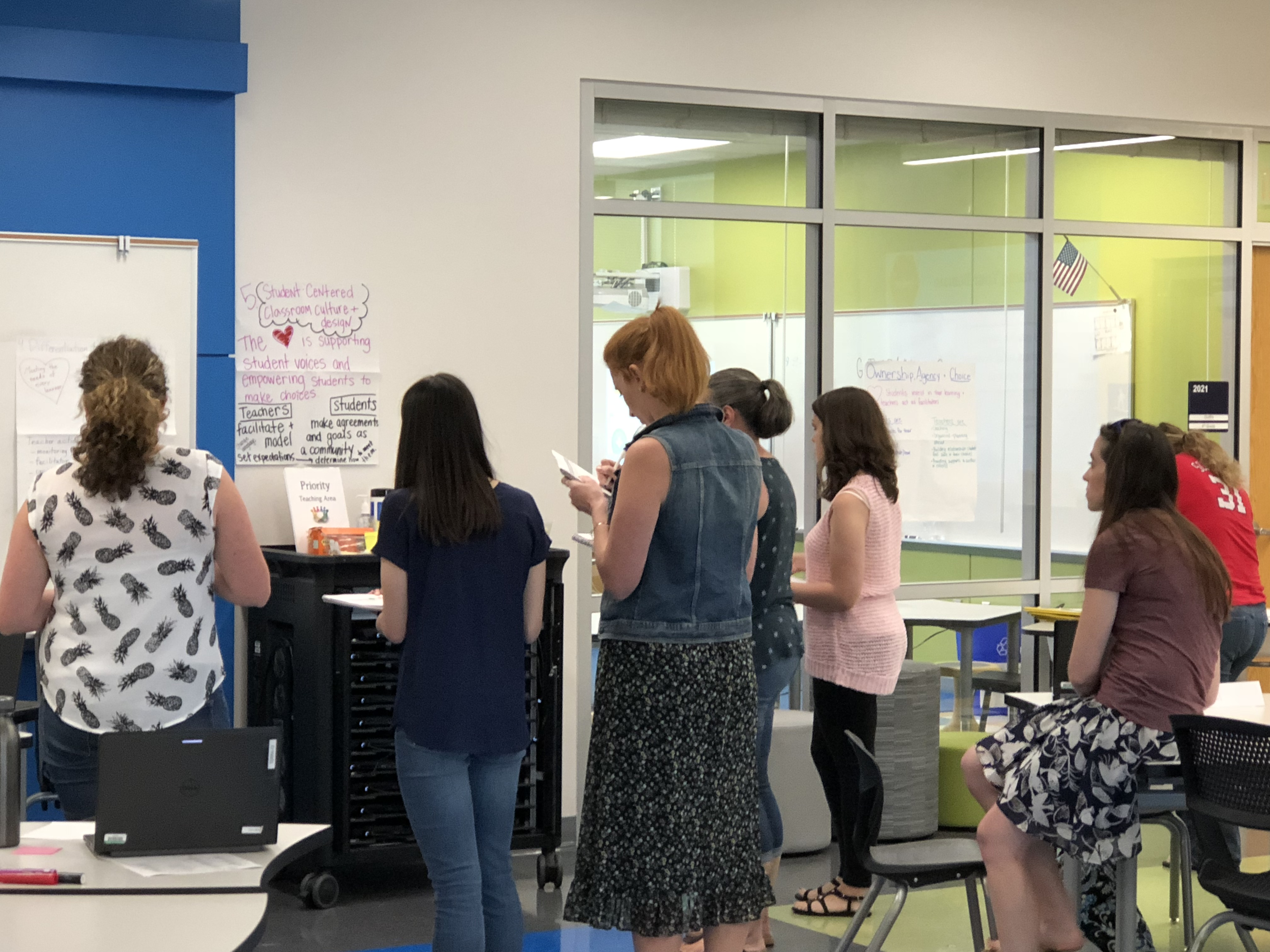 Teachers participate in a Gallery Walk on day one of the Design Studios