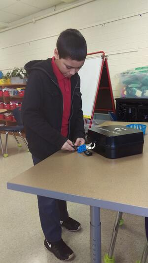 Student standing with the breakout box